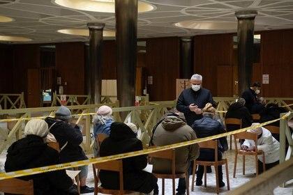 Cardinal Konrad Krajewski oversees the inoculation of the homeless (Reuters)