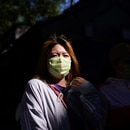 A woman walks down the street, wearing a mask during the COVID-19 pandemic in Beijing, China September 18, 2020. REUTERS/Tingshu Wang