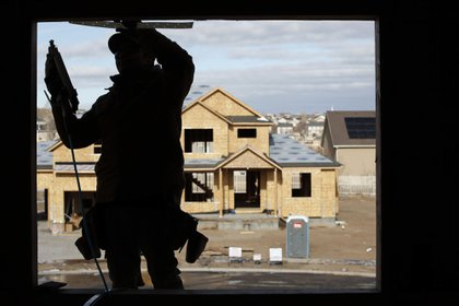 A contractor frames a house under construction in Lehi, Utah, U.S., on Wednesday, Dec. 16, 2020. Private residential construction in the U.S. rose 2.7% in November. Photographer: George Frey/Bloomberg