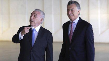 Michel Temer y Mauricio Macri, presidentes post bolivarianos (AP Photo/Eraldo Peres)