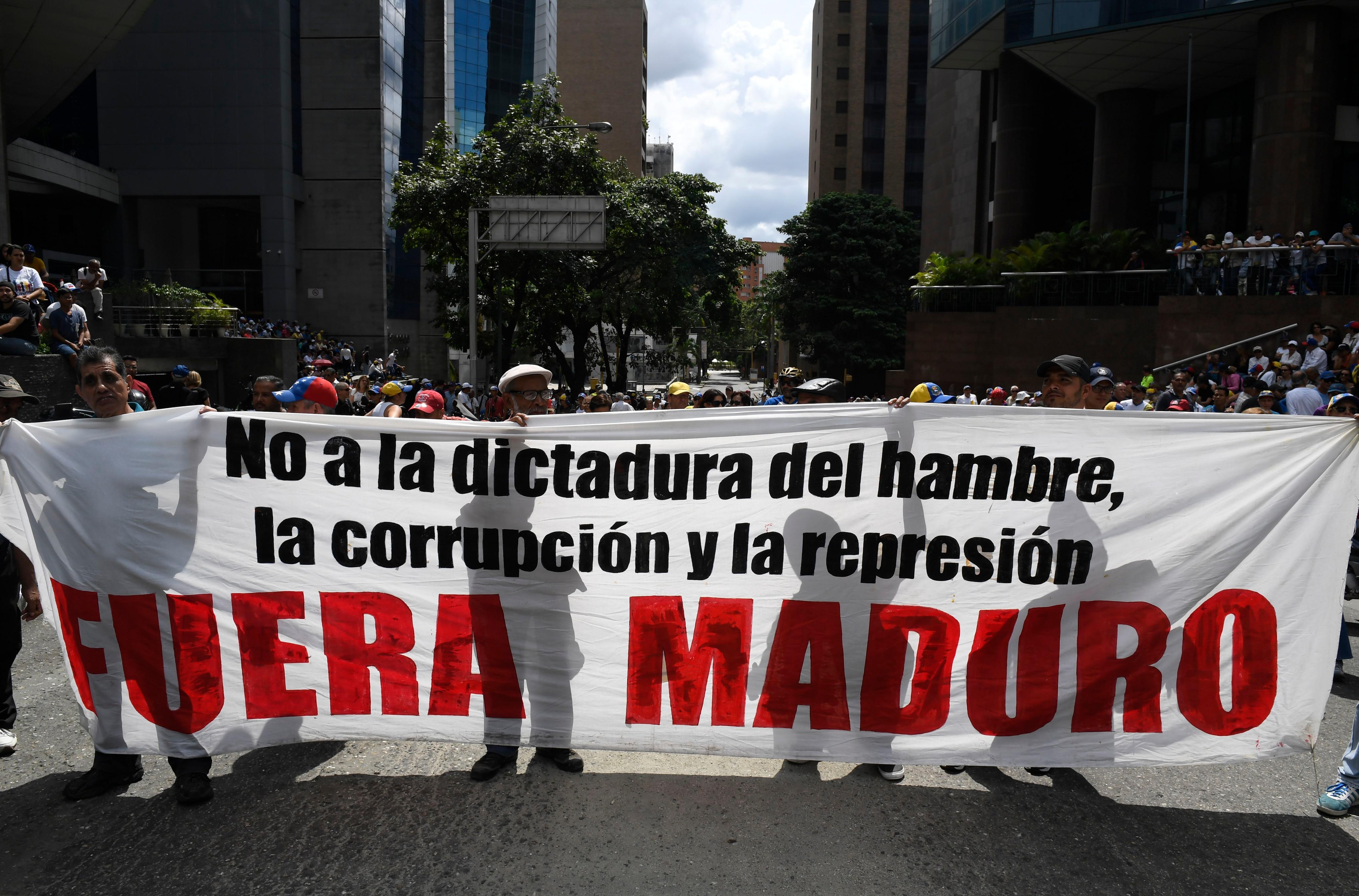 Protesta en Caracas contra el régimen de Nicolás Maduro. (Photo by Federico PARRA / AFP)