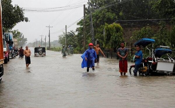 Una calle inundad en Luzon, Filipinas (REUTERS/Erik De Castro)