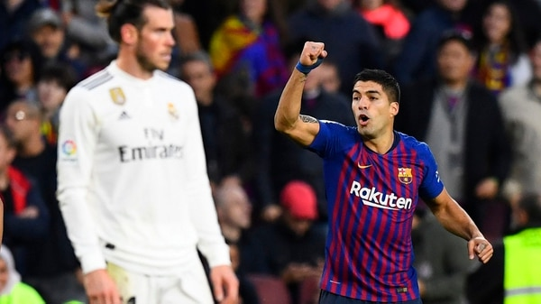 Barcelona's Uruguayan forward Luis Suarez (R) celebrates his second goal during the Spanish league football match between FC Barcelona and Real Madrid CF at the Camp Nou stadium in Barcelona on October 28, 2018. (Photo by GABRIEL BOUYS / AFP)