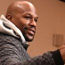 US boxing superstar Floyd Mayweather Jr gives a thumbs up at the end of a press conference at a Tokyo hotel on December 29, 2018. - Mayweather will fight against Japanese kickboxer Tenshin