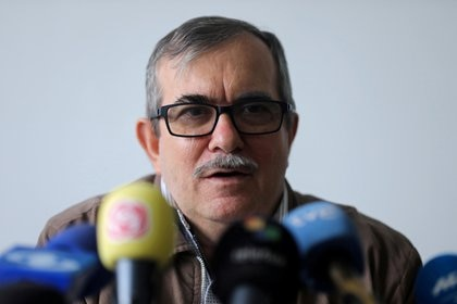 FILE PHOTO: Rodrigo Londono, known by his nom de guerre Timochenko, former commander of the Revolutionary Armed Forces of Colombia (FARC) speaks during a news conference at Special Jurisdiction for Peace tribunal in Bogota, Colombia September 23, 2019. REUTERS/Luisa Gonzalez/File Photo