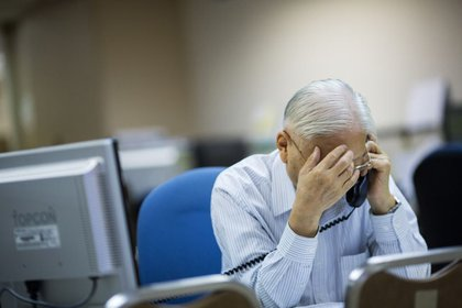 A stockbroker at a securities brokerage in Hong Kong, China Photographer: Jerome Favre/Bloomberg