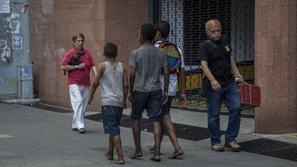 Niños venezolanos por las calles de Caracas (EFE)