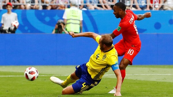 Soccer Football – World Cup – Quarter Final – Sweden vs England – Samara Arena, Samara, Russia – July 7, 2018 England's Raheem Sterling has a shot at goal as Sweden's Andreas Granqvist attempts to block REUTERS/Michael Dalder