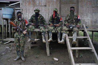 Stock Photo.  Guerrillas of the National Liberation Army (ELN) rest in front of a house in a jungle area of the department of Chocó, Colombia, August 31, 2017. REUTERS / Federico Rios