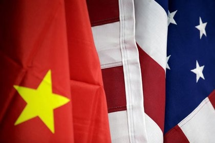FILE PHOTO.  The flags of China and the United States, in Beijing, China.  March 28, 2019. REUTERS / Jason Lee