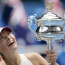 FILE PHOTO: Tennis - Australian Open - Melbourne Park - Australia - January 26, 2008 Russia's Maria Sharapova celebrates winning the Australian Open with trophy Action Images via Reuters/Brandon Malone/File Photo