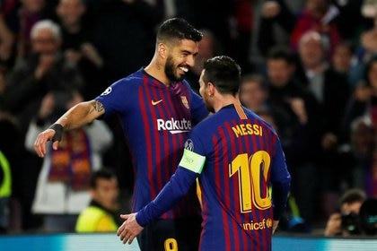 Suárez y Messi volverán a verse las caras en una cancha cuando se midan Atlético Madrid y Barcelona en noviembre próximo (REUTERS/Susana Vera)