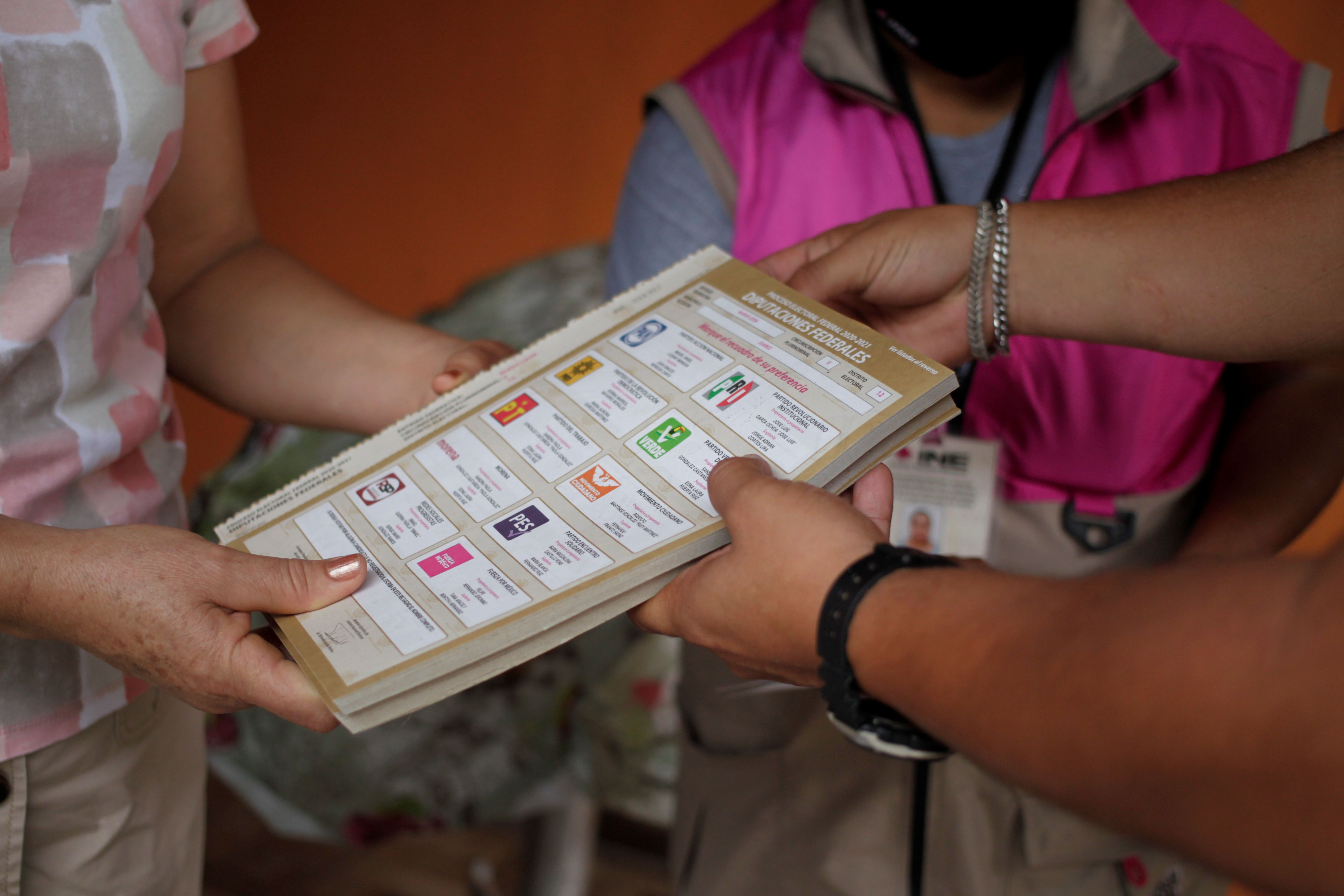 Leticia Gonzalez, selected as a polling station officer by the National Electoral Institute (INE) receives voting materials ahead of the mid-term elections on June 6, in Juarez, on the outskirts of Monterrey, Mexico June 3, 2021. REUTERS/Daniel Becerril