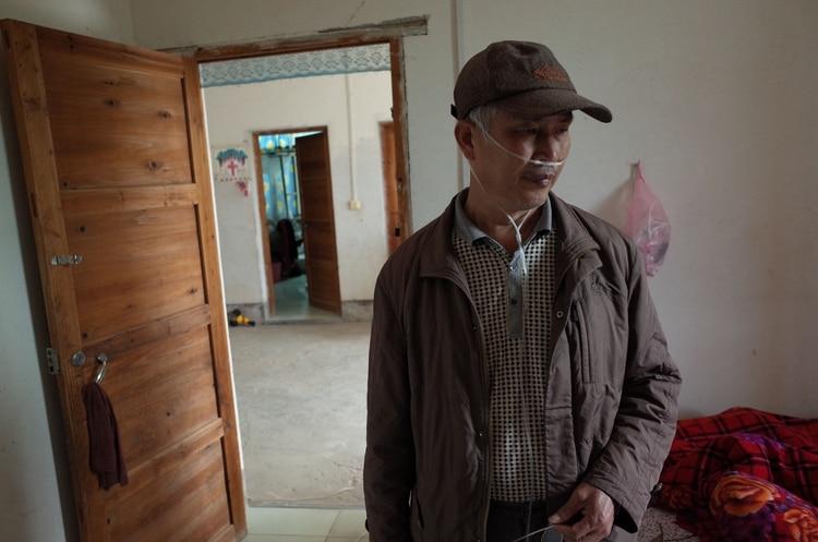 Wang Quanlong fue uno de los 80 perforadores enfermos que amenazaron con suicidarse en masa si las autoridades de Shenzhen no pagaban una indemnización por la neumoconiosis (The Washington Post / Gerry Shih)