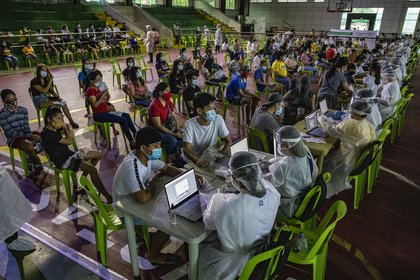 Residents queue for free COVID-19 swab testing at a basketball court on August 6, 2020 in Navotas city, Metro Manila, Philippines.