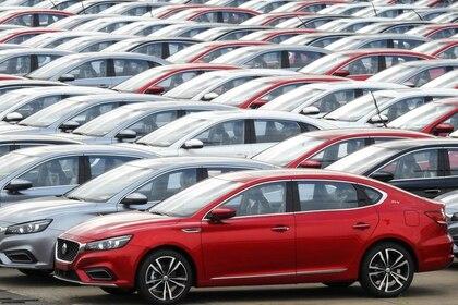 FOTO DE ARCHIVO. Automóviles para exportación esperan ser cargados en buques en un puerto en Lianyungang, provincia de Jiangsu, China. 14 de octubre de 2019. REUTERS/Stringer.