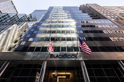 American flags fly at the entrance to BlackRock Inc. headquarters in New York, U.S, on on Thursday, July 9, 2020. BlackRock is scheduled to release earnings figures on July 17.