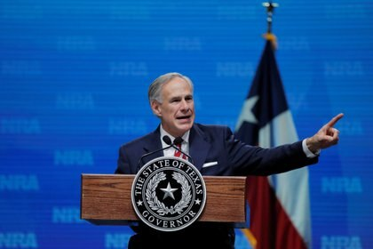 FILE PHOTO: Texas Governor Greg Abbott speaks at the annual National Rifle Association (NRA) convention in Dallas, Texas, U.S., May 4, 2018. REUTERS/Lucas Jackson/File Photo