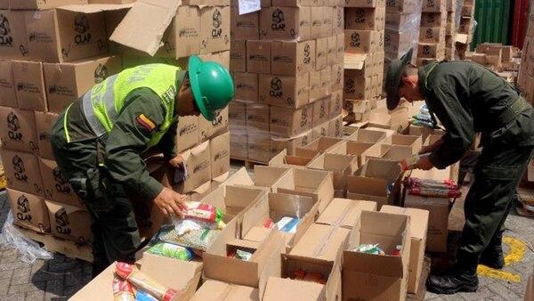 Incautación de 400 toneladas de alimentos descompuestos en el puerto de Cartagena, con destino a Venezuela.