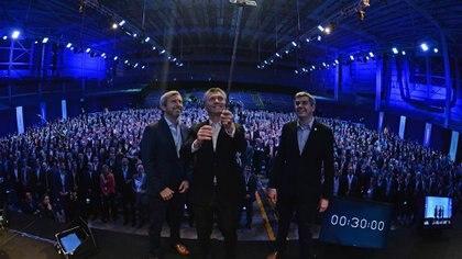 El ministro del Interio, Rogelio Frigerio, el presidente Mauricio Macri, y el jefe de Gabinete, Marcos Peña