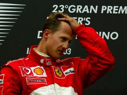 FILE PHOTO: ON THIS DAY Ð APRIL 20  April 20, 2003     FORMULA ONE - Ferrari's Michael Schumacher is overcome with emotion on the winners podium after claiming victory in the San Marino Grand Prix at Imola just hours after his mother Elisabeth, who was in a coma, died in Cologne.     Michael and his younger brother Ralf had flown by private jet to visit her on Saturday before returning for the race where both had qualified on the front of the grid.     While Ralf finished fourth in his Williams-BMW, Michael beat Kimi Raikkonen and team mate Rubens Barrichello to the chequered flag. None of the drivers sprayed champagne on the podium. REUTERS/Dylan Martinez/File Photo