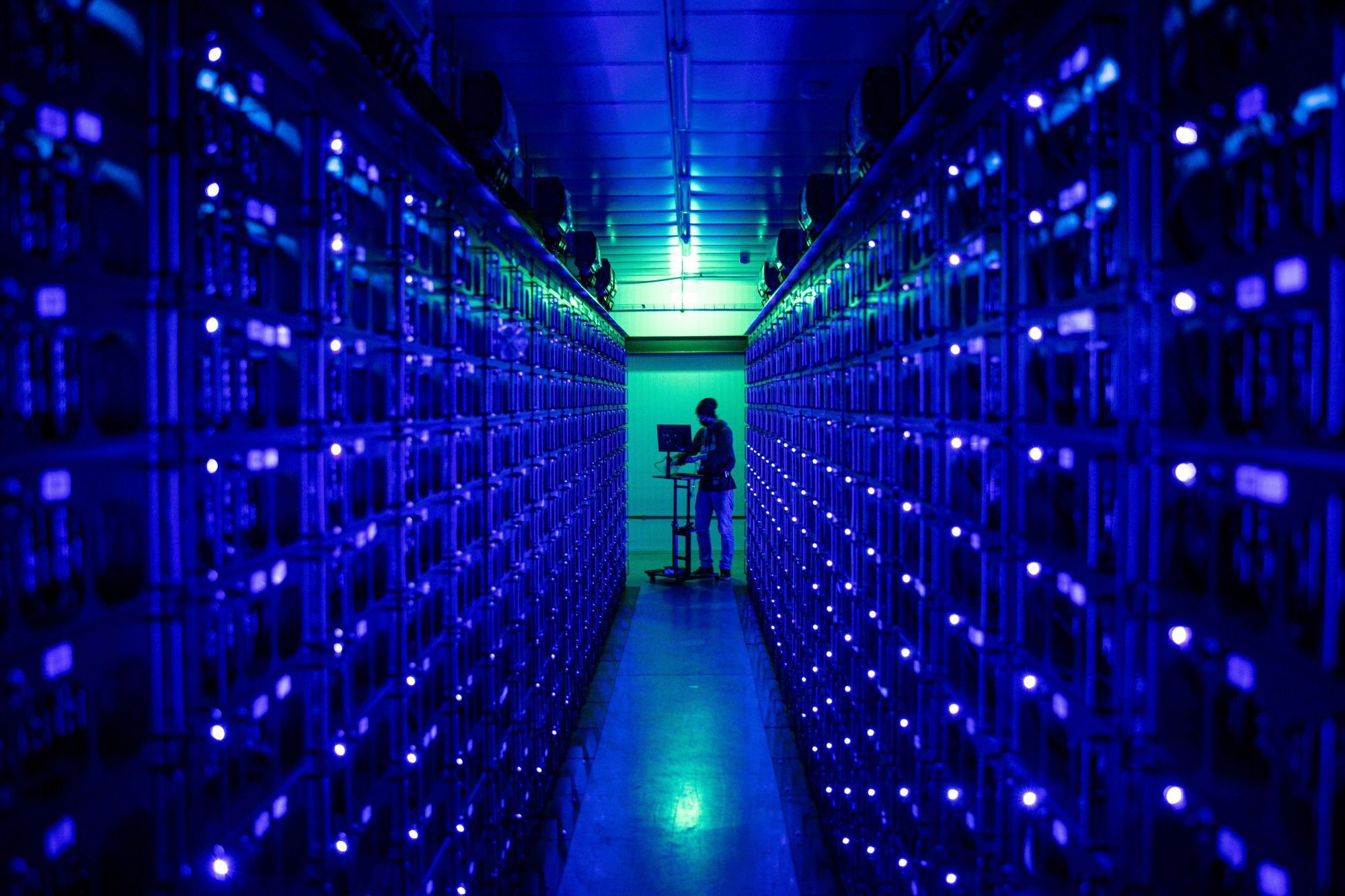 An engineer runs diagnostics on rigs mining the Ethereum and Zilliqa cryptocurrencies at the Evobits crypto farm in Cluj-Napoca, Romania, on Wednesday, Jan. 22, 2021. The world's second-most-valuable cryptocurrency, Ethereum, rallied 75% this year, outpacing its larger rival Bitcoin. Photographer: Akos Stiller/Bloomberg