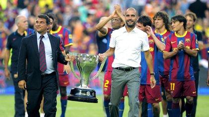 Guardiola llegó de la mano de Joan Laporta (Foto: AFP)