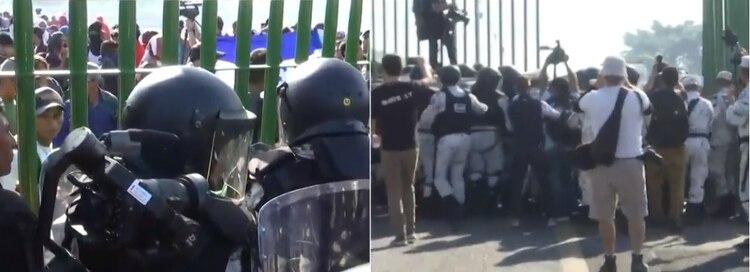 Las cientos de personas intentaron ingresar fueron rápidamente contenidos por el equipo anti motines de la Guardia Nacional Foto: (Impresión de pantalla Noticieros Televisa)