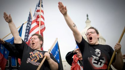 NSM members on the grounds of the U.S. Capitol National Socialist Movement Organization march and protest against illegal immigration in Washington, DC,  Shutterstock
