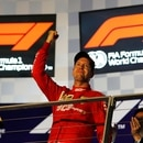 Formula One F1 - Singapore Grand Prix - Marina Bay Street Circuit, Singapore - September 22, 2019 Ferrari's Sebastian Vettel celebrates on the podium after winning the race REUTERS/Tim Chong