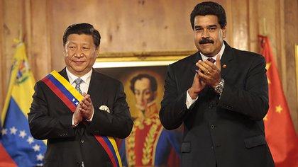 Xi Jinping y Nicolás Maduro en Caracas, en 2017