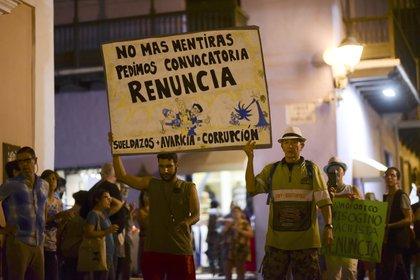 Los reclamos también apuntan contra la corrupción y la ola de arrestos(AP Photo/Carlos Giusti)