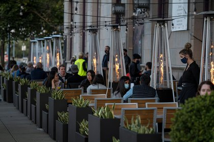 People sit in an outdoor dining area at a restaurant in San Francisco, California, U.S., on Wednesday, Aug. 5, 2020. California's second round of coronavirus-related shutdowns, among the nation's strictest measures, are already causing pain for the most populous state's labor market and portend a deterioration in the overall U.S. employment picture for July. Photographer: David Paul Morris/Bloomberg