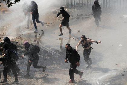 Incidentes durante la manifestación a 47 años del Golpe Militar. REUTERS/Ivan Alvarado