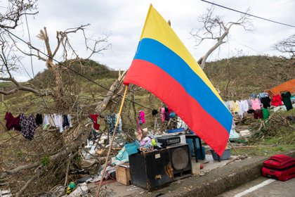 A Colombian flag is seen next to recovered personal items after the passing of Storm Iota, in Providencia, Colombia November 18, 2020. Efrain Herrera / Colombia Presidency / Handout via REUTERS ATTENTION EDITORS - THIS IMAGE HAS BEEN SUPPLIED BY A THIRD PARTY.  DO NOT RESALS.  NO FILES.