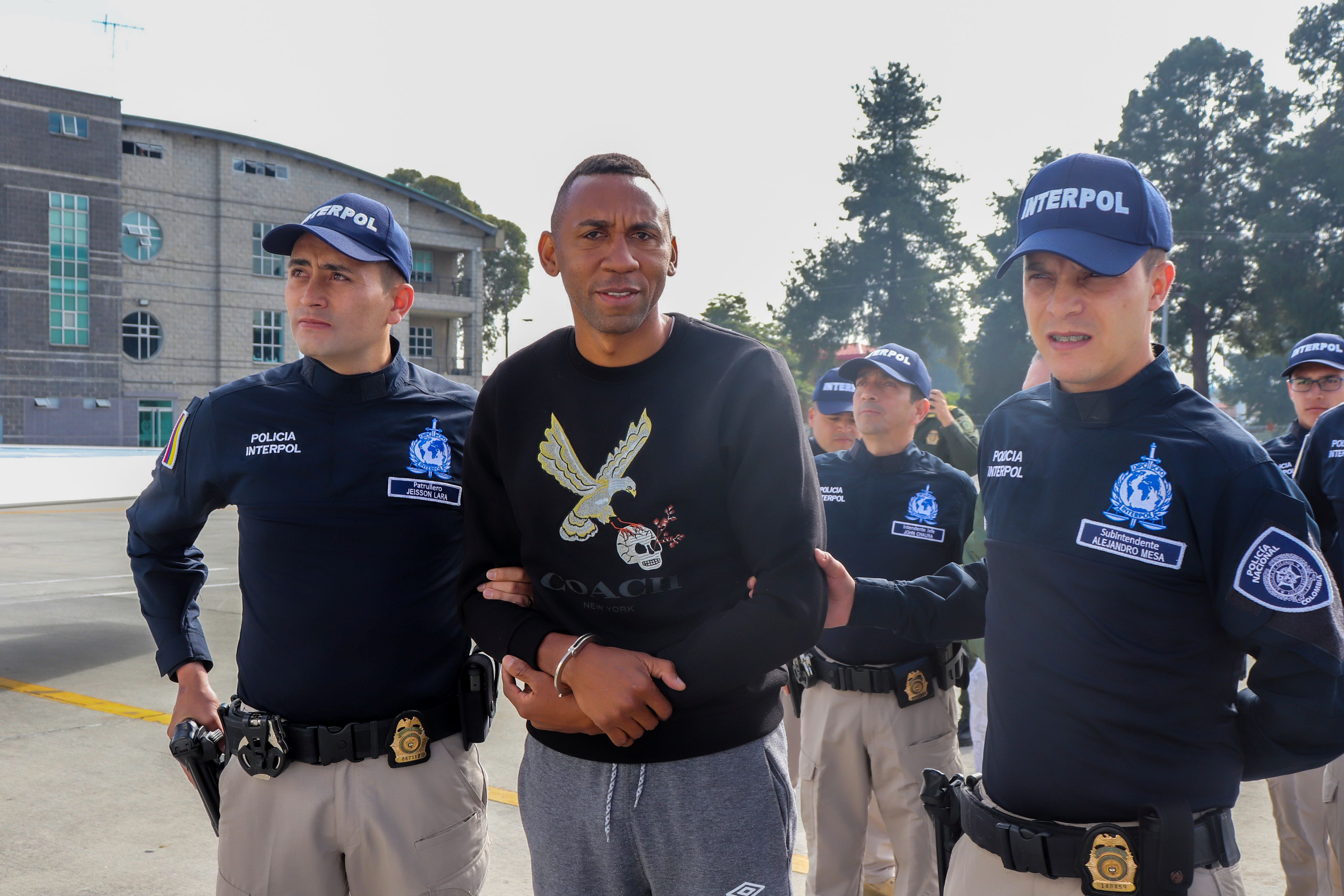 Colombia's former soccer player Jhon Viafara, is escorted by the police, before being extradited to the U.S., to answer for alleged drug trafficking crimes, at an airport in an anti-narcotics base in Bogota, Colombia January 23, 2020. Colombian Police/Handout via REUTERS ATTENTION EDITORS - THIS IMAGE WAS PROVIDED BY A THIRD PARTY