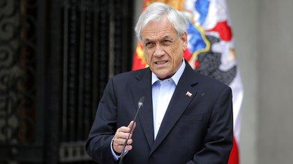 El presidente chileno Sebastián Piñera se dirige a la nación en Santiago, el 26 de octubre de 2019 (Foto de Pedro Lopez / AFP)