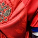 A picture shows the new Adidas-designed jersey of the Russian national football team at an official Adidas store in Moscow on November 13, 2019. - Russia's football authorities said on November 13, 2019 the national team will not be wearing new Adidas-designed shirts in upcoming Euro-2020 qualifiers after some pointed out they reverse the colours of the Russian flag. (Photo by Kirill KUDRYAVTSEV / AFP)