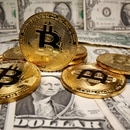 FILE PHOTO: Representations of virtual currency Bitcoin are placed on U.S. Dollar banknotes in this illustration taken May 26, 2020. REUTERS/Dado Ruvic/File Photo