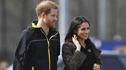 El príncipe Harry y Meghan Markle se conocieron en una cita a ciegas que organizó un amigo en común de la pareja. Están juntos desde 2016  (AFP)