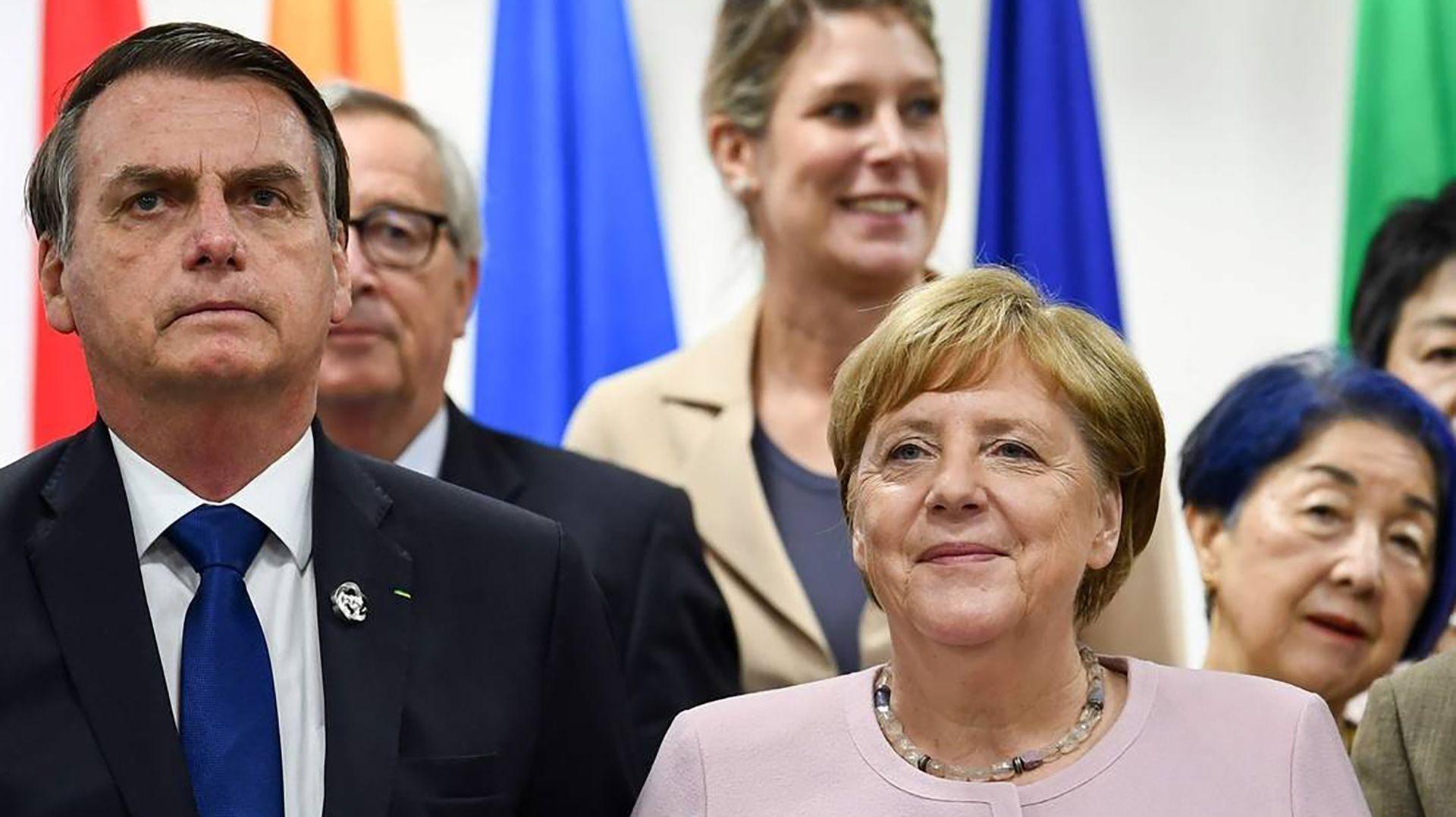 Jair Bolsonaro y Angela Merkel (AFP)