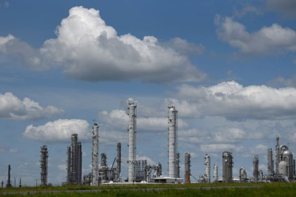 Total SE refinery stands in Port Arthur, Texas, U.S., on Monday, Aug. 24, 2020. Oil and chemical facilities located along the Texas Gulf Coast are shuttering, securing equipment or running through emergency protocols ahead of a strong hurricane set to rip through the region this week.