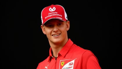 FILE PHOTO: FILE PHOTO: FILE PHOTO: Racing driver Mick Schumacher attends an event to celebrate 90 years of Italian premium sports car maker Ferrari racing team at Milan's Duomo square, in Milan, Italy September 4, 2019. REUTERS/Flavio lo Scalzo/File Photo/File Photo
