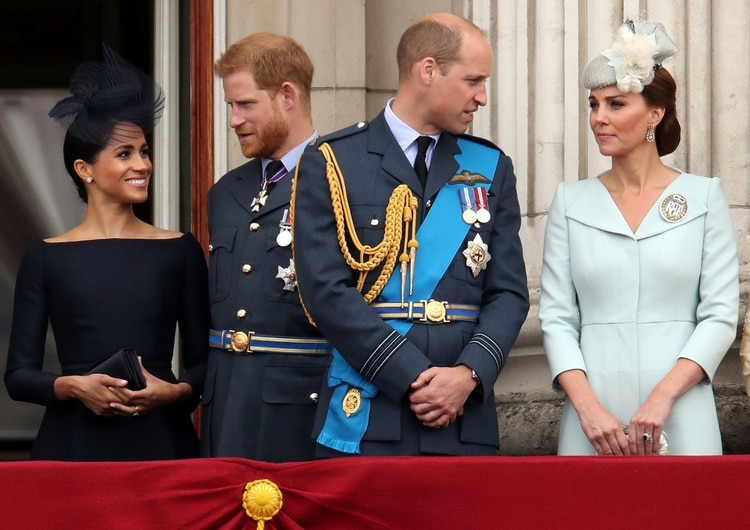 Britain's Meghan, Duchess of Sussex, Prince Harry, Prince William, Catherine, Duchess of Cambridge stand on the balcony of Buckingham Palace as they watch a fly past to mark the centenary of the Royal Air Force in central London, Britain July 10, 2018. REUTERS/Chris Radburn