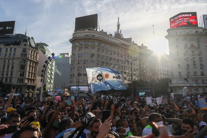 Fans of late Argentine soccer legend Diego Armando Maradona gather during a protest to demand justice after the death of the idol, at the Buenos Aires' Obelisk, Argentina March 10, 2021. REUTERS/Agustin Marcarian