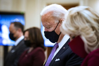 U.S. President Joe Biden and First Lady Jill Biden bow their heads during a virtual presidential inaugural prayer service in the State Dining Room of the White House in Washington, D.C., U.S., on Thursday, Jan. 21, 2021. President Biden in his first full day in office plans to issue a sweeping set of executive orders to tackle the raging Covid-19 pandemic that will rapidly reverse or refashion many of his predecessor's most heavily criticized policies.