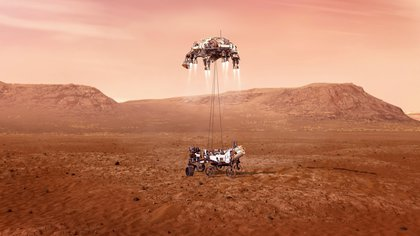 Fotografía cedida este miércoles por la Administración Nacional de Aeronáutica y el Espacio (NASA) que muestra una ilustración del rover Perseverance mientras aterriza de forma segura sobre la superficie de Marte. EFE/ Emma Howells/ NASA