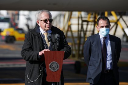 Mexico's health Minister Jorge Alcocer gives a speech next to Finance Minister Arturo Herrera after the landing of a plane carrying a batch of doses of COVID-19 vaccine at Benito Juarez International Airport, as the coronavirus disease (COVID-19) outbreak continues, in Mexico City, Mexico, January 19, 2021. REUTERS/Henry Romero
