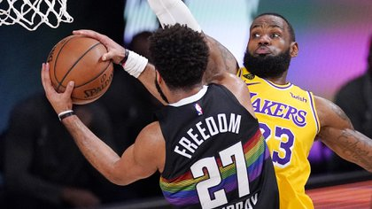 Denver Nuggets' Jamal Murray (27) drives against Los Angeles Lakers' LeBron James (23) and scores during the first half of an NBA conference final playoff basketball game Thursday, Sept. 24, 2020, in Lake Buena Vista, Fla. (AP Photo/Mark J. Terrill)