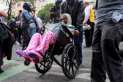 A woman in a wheelchair is seen outside a hospital after an earthquake in Mexico City, Mexico June 23,2020. REUTERS/ Carlos Jasso